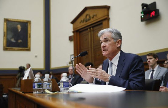 Fed chief Powell's comments on trade woes hammer dollar