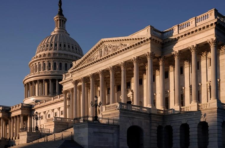 Huge spending bill passes 50-49